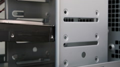 Installing hard drive at computer case Stock Footage