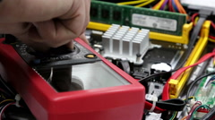 Multimeter, measurement of the voltage in the motherboard Stock Footage