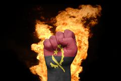 Stock Photo of fire fist with the national flag of angola