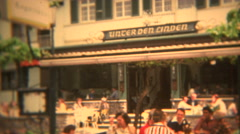 1973: German beer garden with people sitting outside in summer. Stock Footage