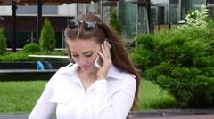 Woman on street mobile speaking Stock Footage