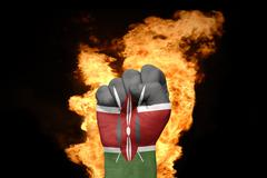 fire fist with the national flag of kenya - stock photo
