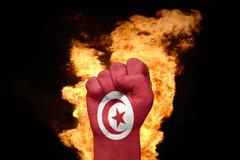 Fire fist with the national flag of tunisia Stock Photos