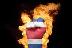 fire fist with the national flag of costa rica - stock photo