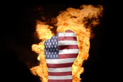 Fire fist with the national flag of united states of america Stock Photos