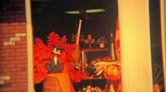 1973: Hand crafted Halloween decorations inside storefront window. Stock Footage