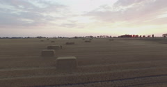 Flying over field with hay bales Stock Footage