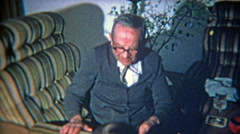 1973: Grandpa tries to love child and gets rejected. - stock footage