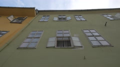 Green and yellow buildings in Sighisoara Stock Footage