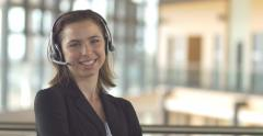 Customer service call centre support receptionist business woman with headset Stock Footage