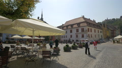 Tourists in Fortress Square, Sighisoara Stock Footage