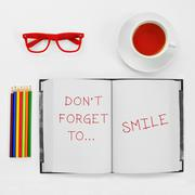text dont forget to smile written in a notepad - stock photo