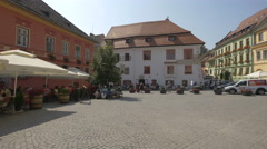 Relaxing in Fortress Square in a beautiful sunny day, Sighisoara Stock Footage