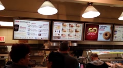 People lined up to ordering food at Tim hortons Stock Footage