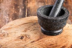 Stone mortar on wooden table Stock Photos