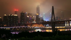 Bridge over jialingjiang river, skyline of chongqing city at night Stock Footage