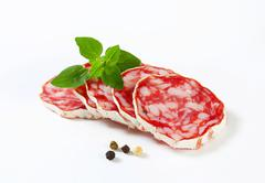 Sliced French Saucisson Sec - studio shot Stock Photos