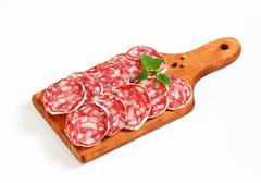 Sliced French Saucisson Sec on cutting board Stock Photos