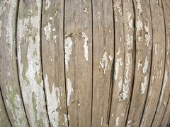 Old wooden fence with peeling off paint Stock Photos
