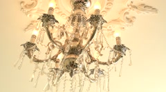 Chandelier swinging from shaking buildings. Stock Footage