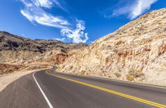 Country curved road in USA, travel concept. Stock Photos