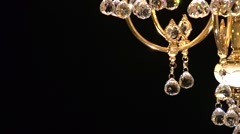 Crystal chandelier on black background. Crystals sway and sparkle. Stock Footage