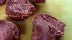 Raw filet mignon beef steaks, on a cutting board Stock Footage