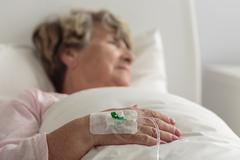 Ill female retiree - stock photo