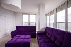 Violet quilted sofa Stock Photos
