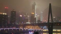 Cruise,bridge over jialingjiang river, skyline of chongqing city at night Stock Footage