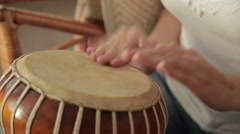 Woman banging a bongo - stock footage