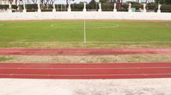 Athletic track stadium, steady cam shoot Stock Footage
