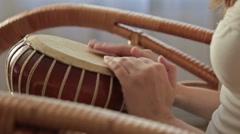 Woman banging a bongo Stock Footage