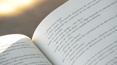 Open book in Spanish or Castilian in a park Stock Footage