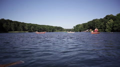 People in boats on a sunny summer day at the lake Stock Footage