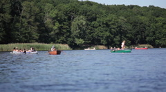 Young people on boats at the lake on a sunny summer day, Belrin Stock Footage