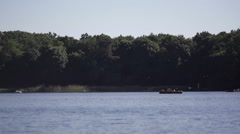 Boats on a beautiful lake in the forest, sunny summer day, Berlin Stock Footage