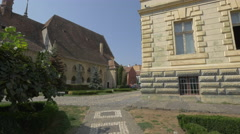 Cobblestone alleys between the Monastery Church and the City Hall, Sighisoara Stock Footage