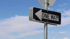 One Way Road Sign in Blue Sky and White Clouds Stock Footage