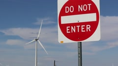 Wind Turbine Rotating in Background of Do Not Enter Sign - stock footage