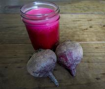 Bright Red Beet Juice in Mason Jar - stock photo