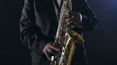 Old african black colored man playing saxophone tuxedo hands - stock footage