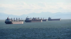 Oil tankers seen from Stanley park Stock Footage