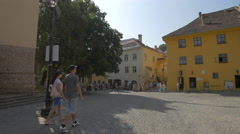 Tourists walking in Museum Square, Sighisoara Stock Footage