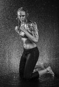 Athletic Woman Kneeling in Boxing Stance in Studio Stock Photos