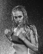 Wet Athletic Woman Posing in Boxing Stance Stock Photos