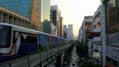 Skytrain coming to station in Bangkok, Thailand Stock Footage