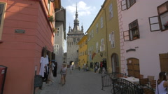 The Clock tower seen from an alley in Sighisoara Fortress Stock Footage