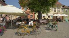 Fortress Square with restaurants in Sighisoara Stock Footage