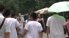 Chinese people walking, Chengdu, Sichuan Stock Footage